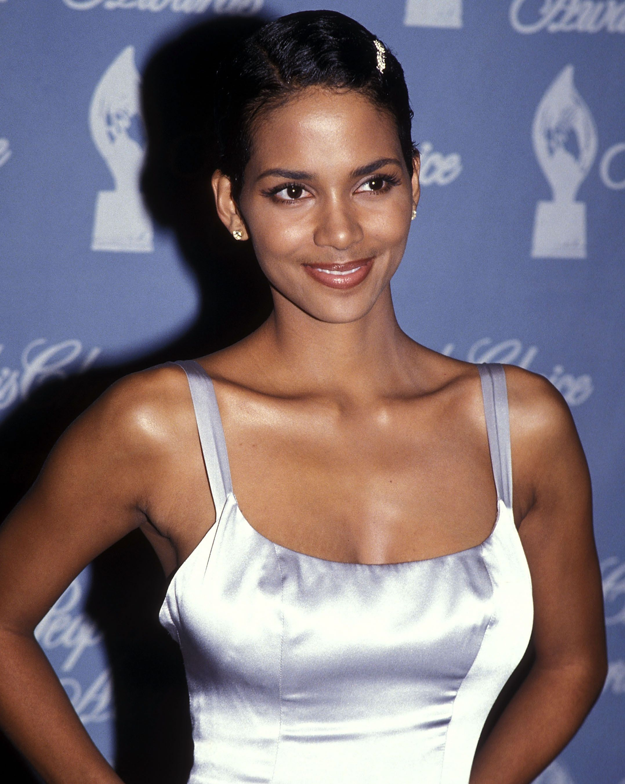 Shine Bright Like A Diamond It seems Halle likes dresses with straps. The style accentuates her toned arms beautifully, especially the shiny number she wore to the 1995 People's Choice Awards.