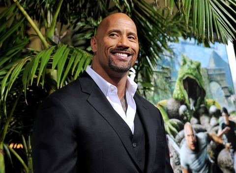 los angeles, ca   february 02  actor dwayne johnson arrives at the premiere of warner bros pictures journey 2 the mysterious island at the chinese theater on february 2, 2012 in los angeles, california  photo by kevin wintergetty images