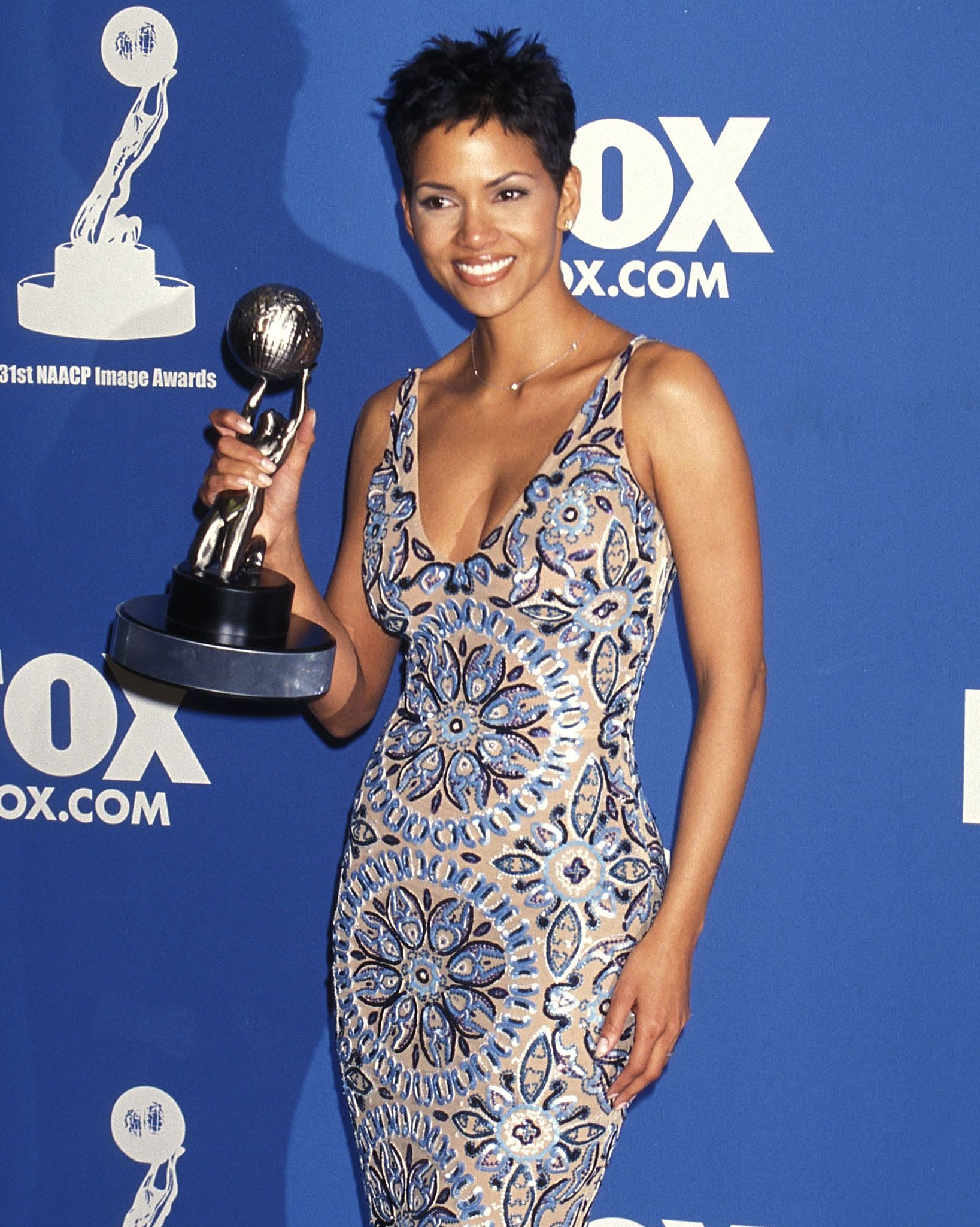 Well-Deserved Wins Berry took home two NAACP Image Awards in 2000, including Entertainer Of The Year. She stunned attendees in the patterned, form-fitted dress and that persistent pixie.