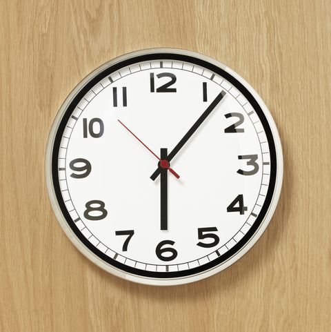 clock on wood panel wall