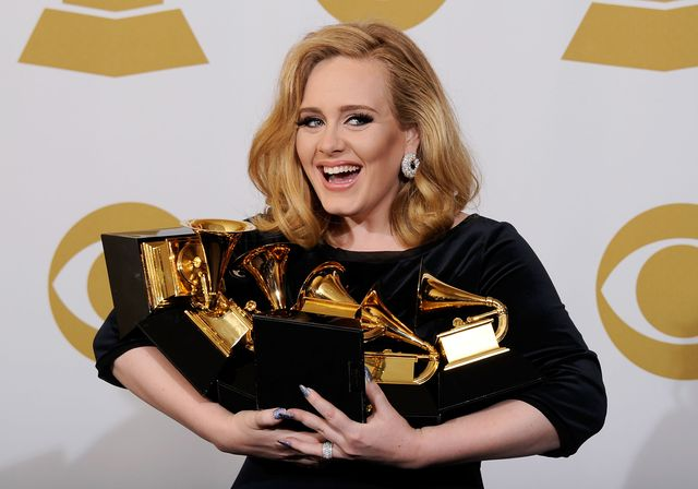 los angeles, ca   february 12  singer adele, winner of the grammys for record of the year for rolling in the deep, album of the year for 21, song of the year for rolling in the deep, best pop solo performance for someone like you, best pop vocal album for 21 and best short form music video for rolling in the deep, poses in the press room at the 54th annual grammy awards at staples center on february 12, 2012 in los angeles, california  photo by kevork djanseziangetty images