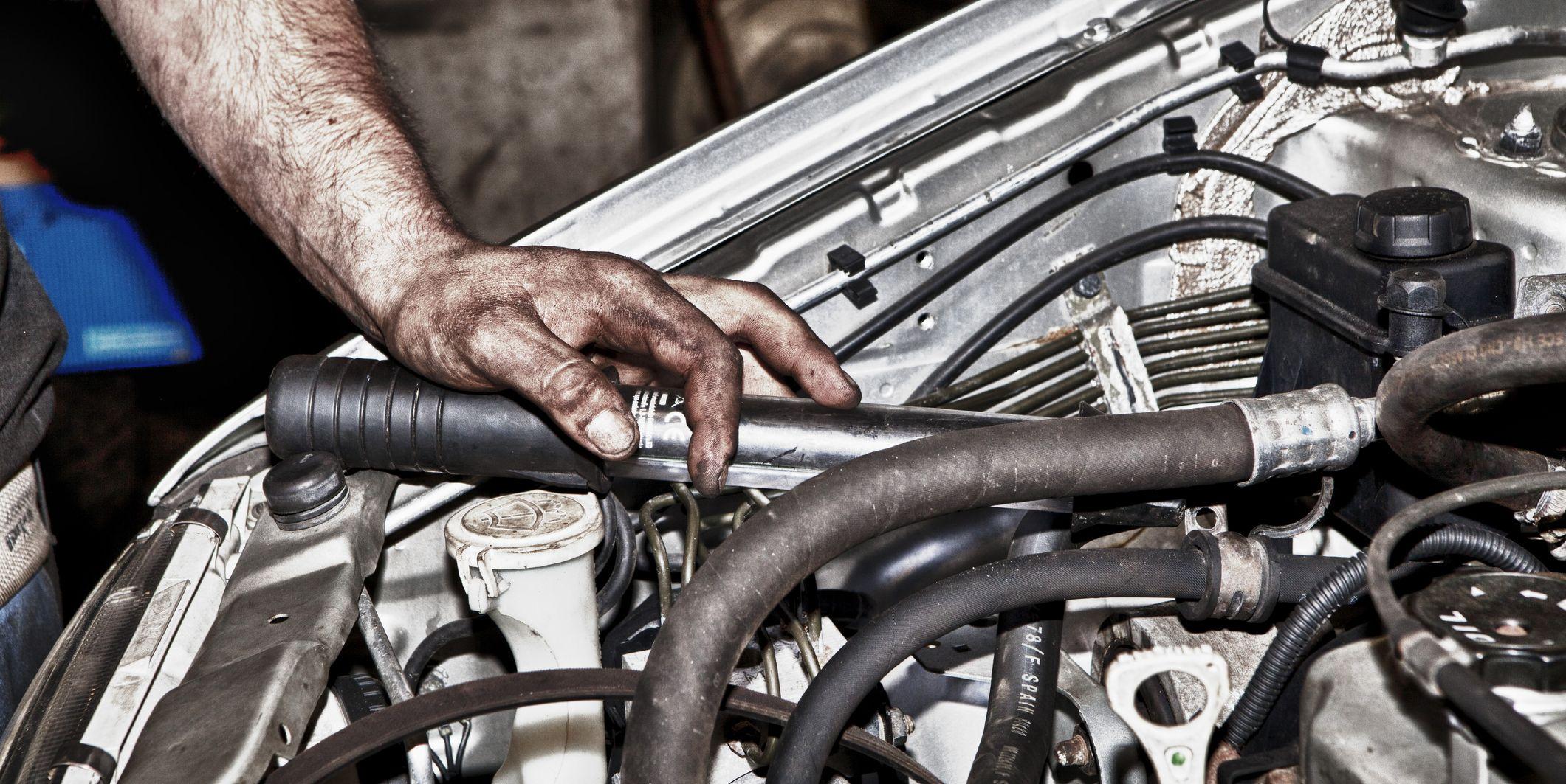 Car mechanic under the hood