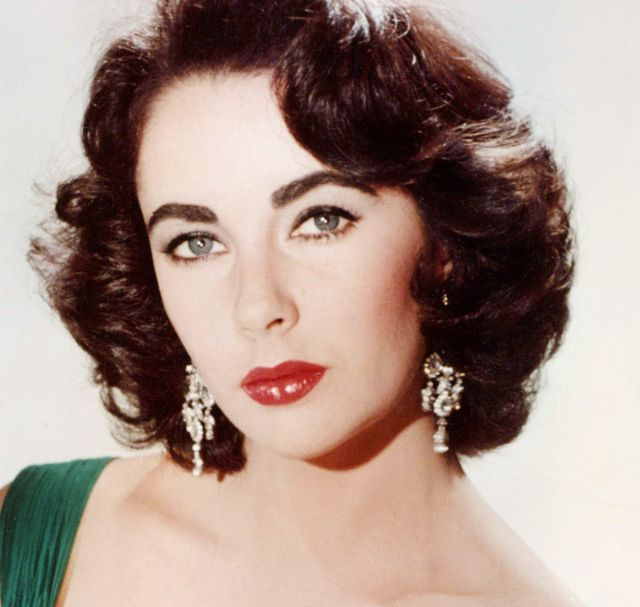 elizabeth taylor 1932 2011, british actress, wearing a green sleeveless low cut dress, with a white fur wrap on the arm of the armchair in which she sits, circa 1950 photo by silver screen collectiongetty images