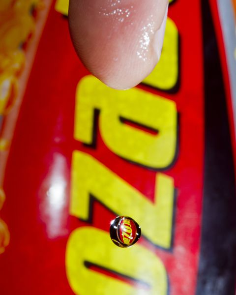 Lucozade reflected in a droplet of sweat from an athletes finger