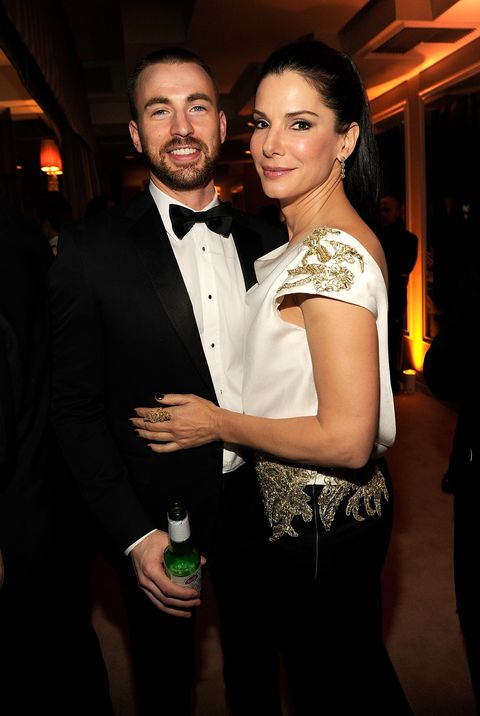 west hollywood, ca   february 26  exclusive access special rates apply no north american on air broadcast until march 1, 2012 chris evans and sandra bullock attend the 2012 vanity fair oscar party hosted by graydon carter at sunset tower on february 26, 2012 in west hollywood, california  photo by kevin mazurvf12wireimage