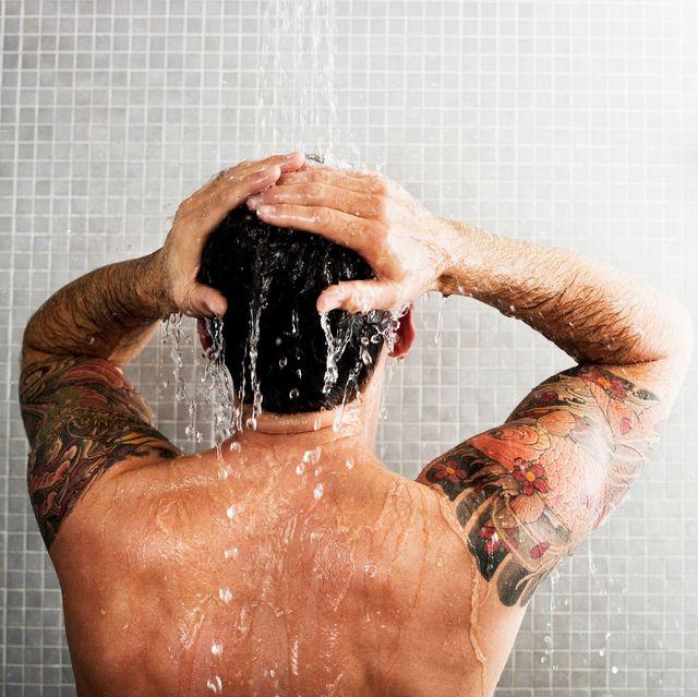 man using scalp scrub