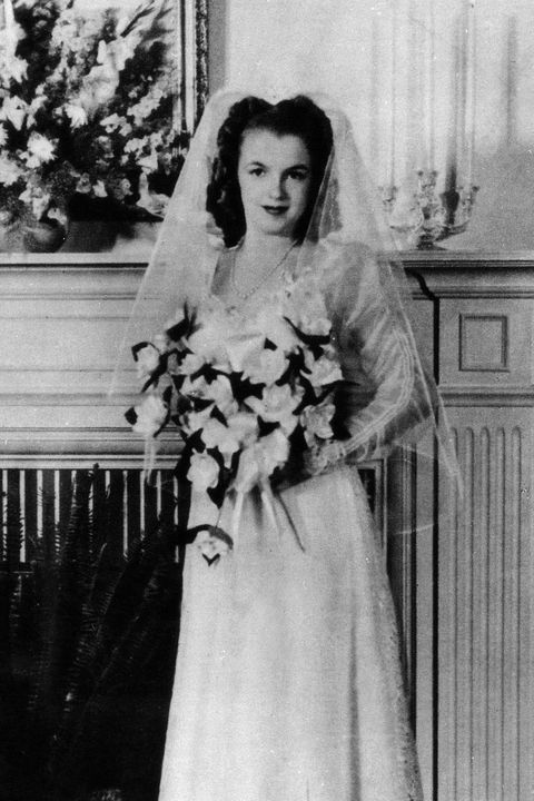 Photograph, Dress, Standing, Gown, Fashion, Vintage clothing, Bouquet, Black-and-white, Classic, Bride,
