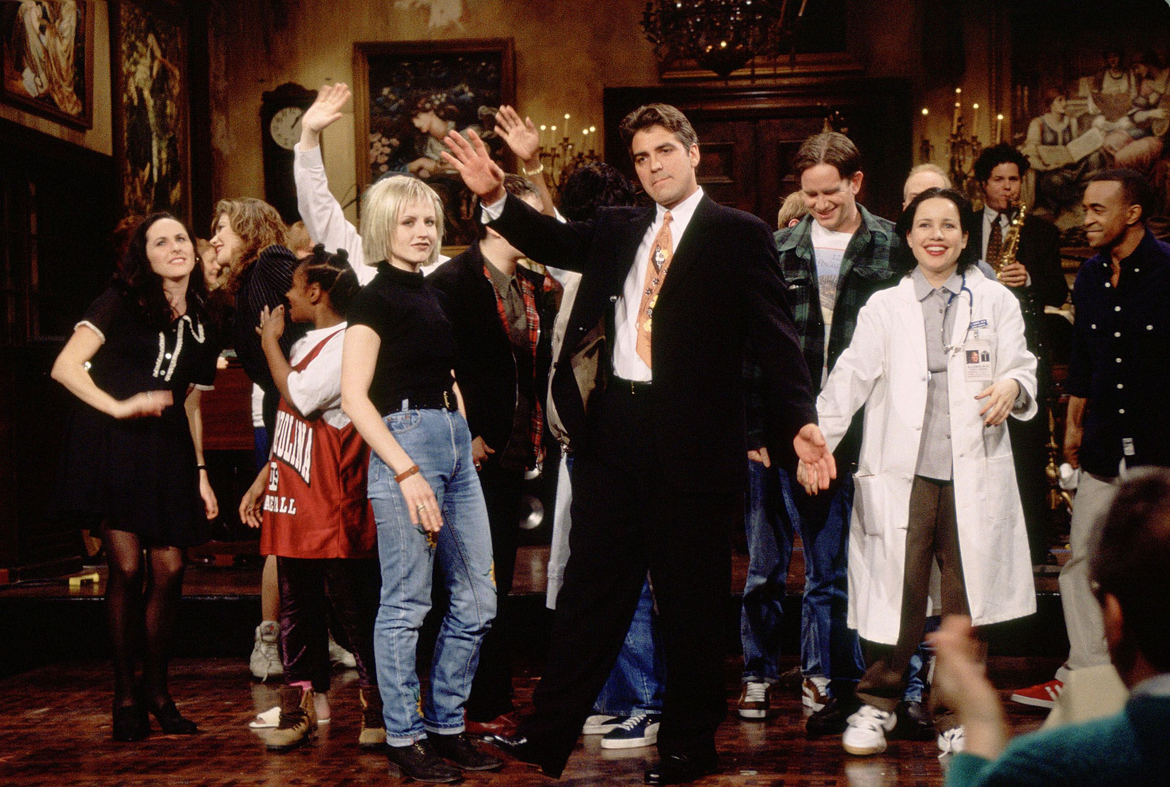 Clooney hosts Saturday Night Live in 1995.