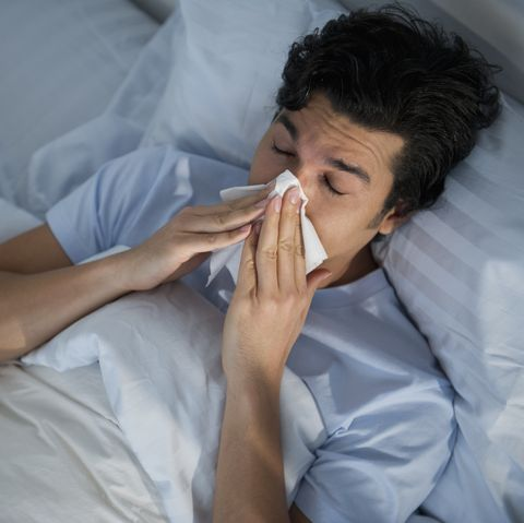 Man with cold and flu symptoms