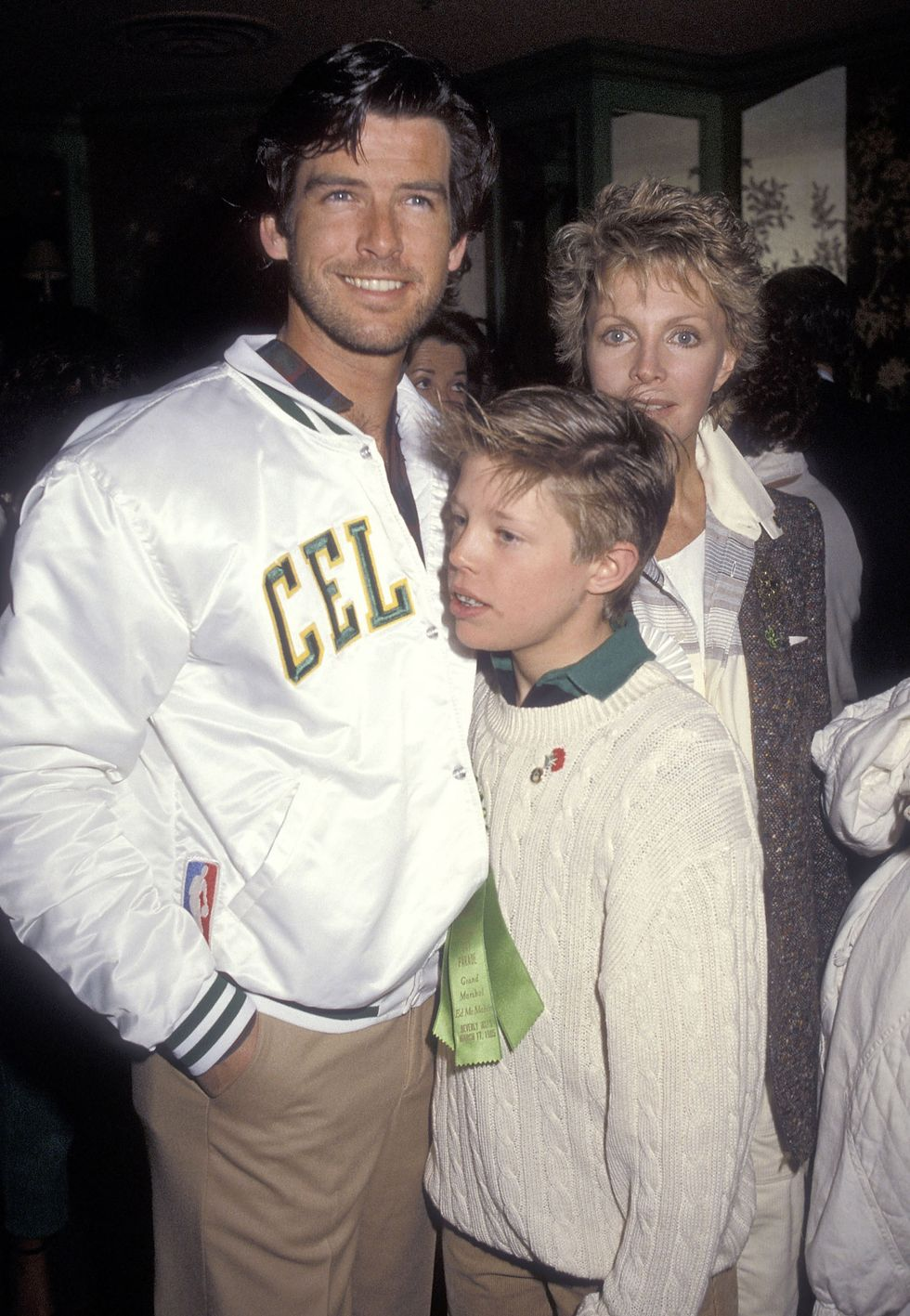 Pierce Brosnan, who is the only Irishman to play James Bond, with his wife Cassandra Harris and son Christopher Harris attending the Beverly Hills St. Patrick's Day Parade Celebrity Brunch on March 17, 1985 at Jimmy's Restaurant in Beverly Hills, California.