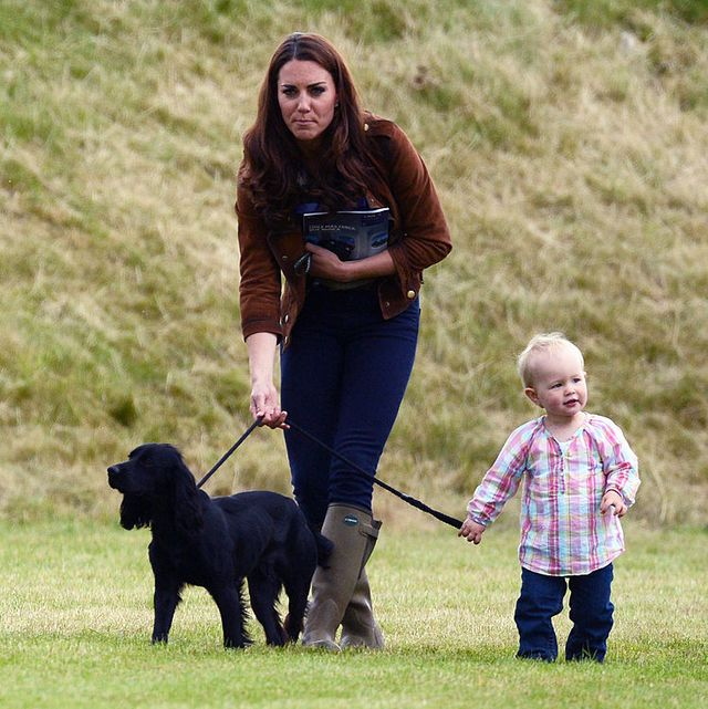 tetbury, united kingdom   june 17  catherine, duchess of cambridge walks lupo with savannah phillips, daughter of peter and autumn phillips at the beaufort polo club on june 17, 2012 in tetbury, england  prince william and prince harry were playing in the golden metropolitan polo club charity cup polo match, raising funds for the charities tusk, the child bereavement charity and well child, whose patrons are the duke of cambridge and prince harry  photo by anwar husseinwireimage