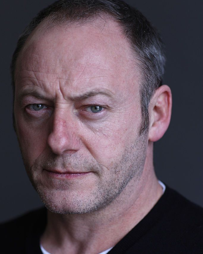 Liam Cunningham (with slight beard) Aside from his unmistakable brow, Cunningham is almost unrecognizable.