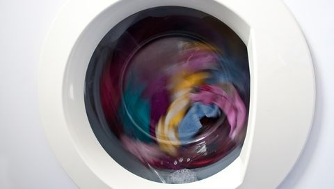 colorful laundry spinning in washing machine