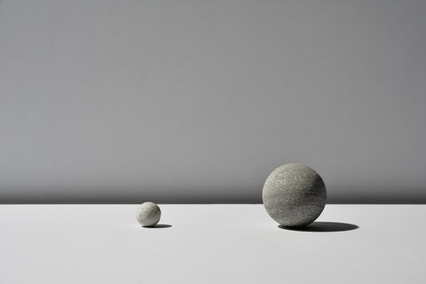 The ball of two stones on white background