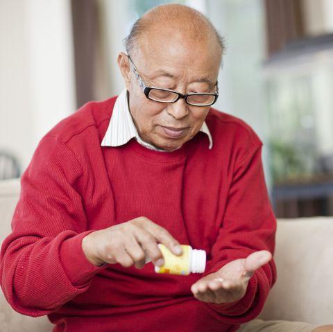 Chinese man taking medication