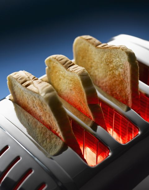 male stomachache or gastroenterologists  concept with healthcare and medicine toast in toaster against blue background