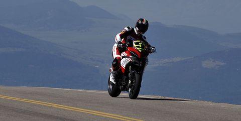 Motorcycle, Motorcycling, Vehicle, Motorsport, Racing, Motorcycle racing, Motorcycle racer, Race track, Sky, Stunt performer,