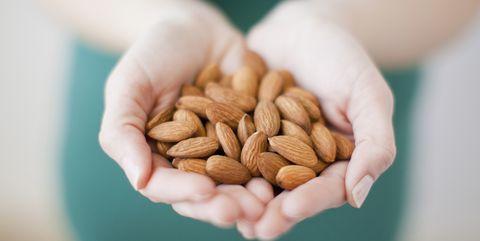 Food, Hand, Plant, Ingredient, Nut, Superfood, Nuts & seeds, Apricot kernel, Produce, Cuisine,
