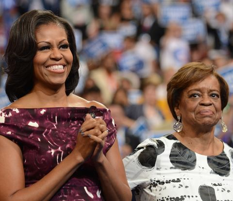 first lady michelle obama and her mother marian robinson clap to a speech at the time warner cable arena in charlotte, north carolina, on september 6, 2012 on the final day of the democratic national convention dnc us president barack obama is expected to accept the nomination from the dnc to run for a second term as president   afp photo  robyn beck        photo credit should read robyn beckafpgettyimages