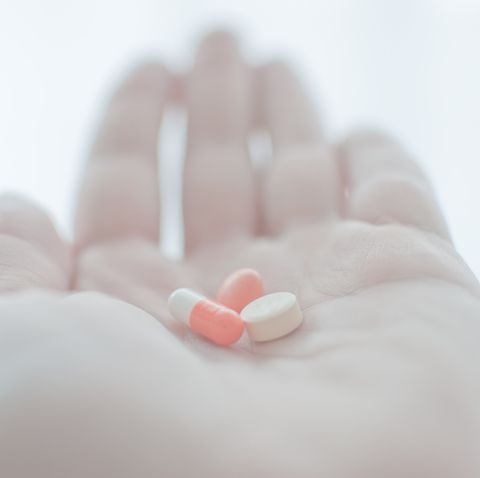 mixture of medicines in a hand