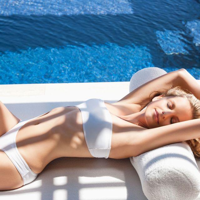 Sun tanning, Bikini, Leg, Beauty, Swimwear, Human leg, Model, Thigh, Undergarment, Vacation,