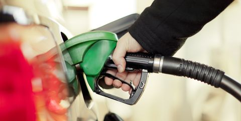 Green, Filling station, Bicycle handlebar, Hand, Gasoline, Vacuum cleaner, Plant, Machine, Business, Vehicle,