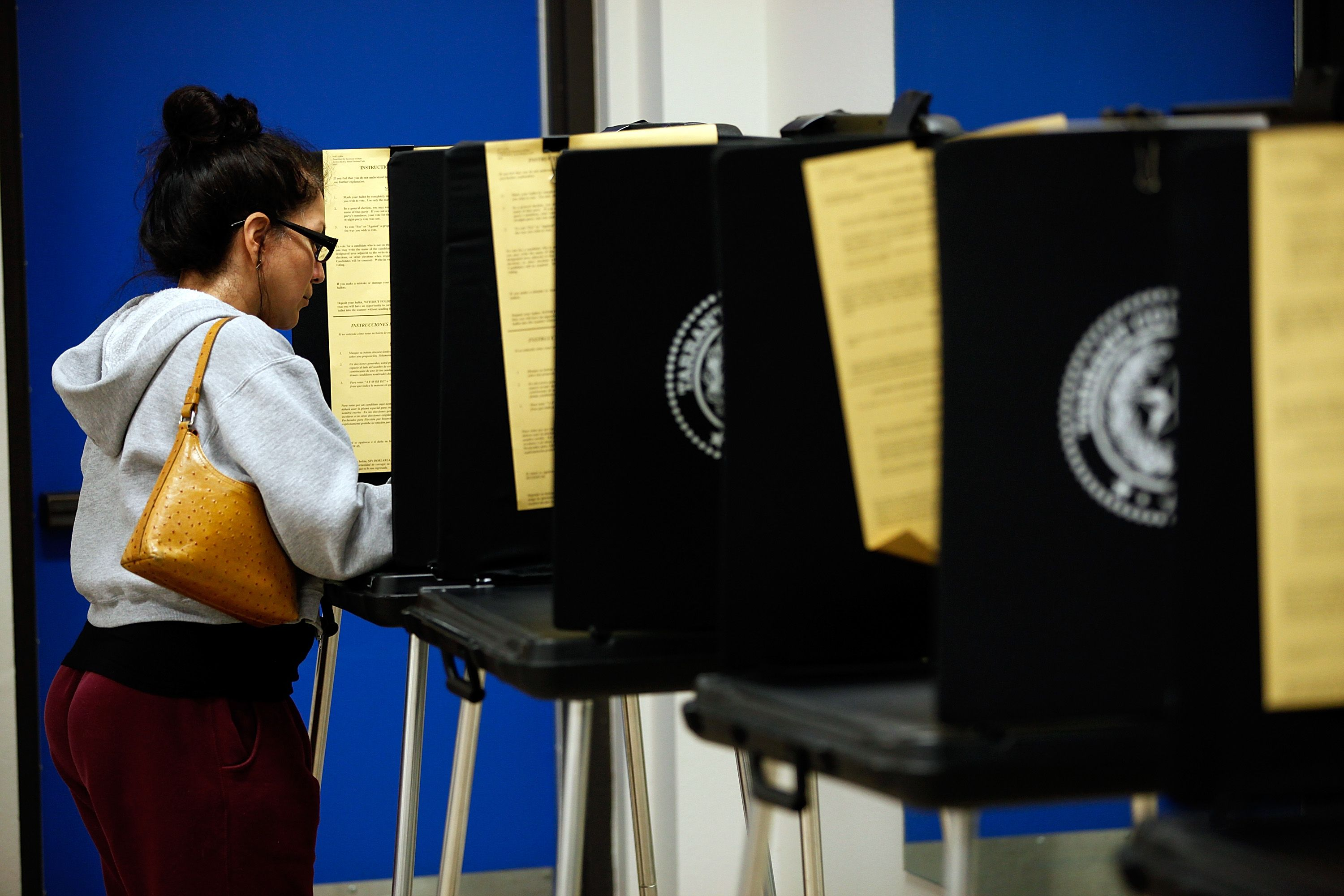 A voter uses an electronic voting machine.