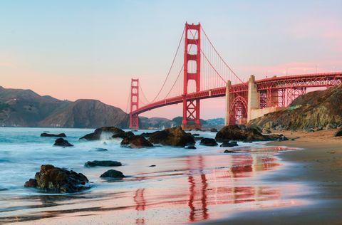 Water, Sky, Sea, Bridge, Landmark, Suspension bridge, Headland, Coast, Ocean, Rock,