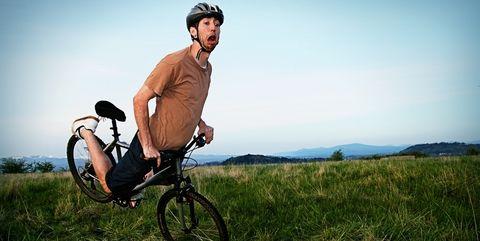 man falling on bike