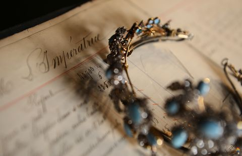 a picture taken on december 18, 2012 shows a 1860 tiara with removable 7 pin drags made of diamonds, turquoise and gold on silver, displayed on a page order of empress eugenie, the wife of napoleon iii, emperor of the french, in the mellerio jewelry store in paris founded in 1613, french jewelry house mellerio is the oldest family owned company in europe and has been making the fifa ballon dor trophy since 1956    afp photo  franck fife        photo credit should read franck fifeafp via getty images