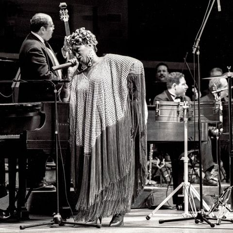 cuban american salsa performer celia cruz 1925   2003 and her band onstage during a jazz at lincoln center concert at alice tully hall, new york, new york, december 12, 1992 photo by jack vartoogiangetty images