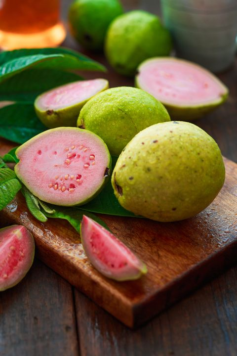 ripe guava fruits on a vintage metal plate and knife