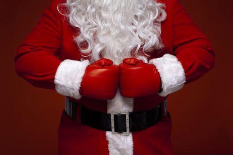 Santa claus, Red, Fictional character, Human body, Facial hair, Christmas, Fur, Boxing glove,