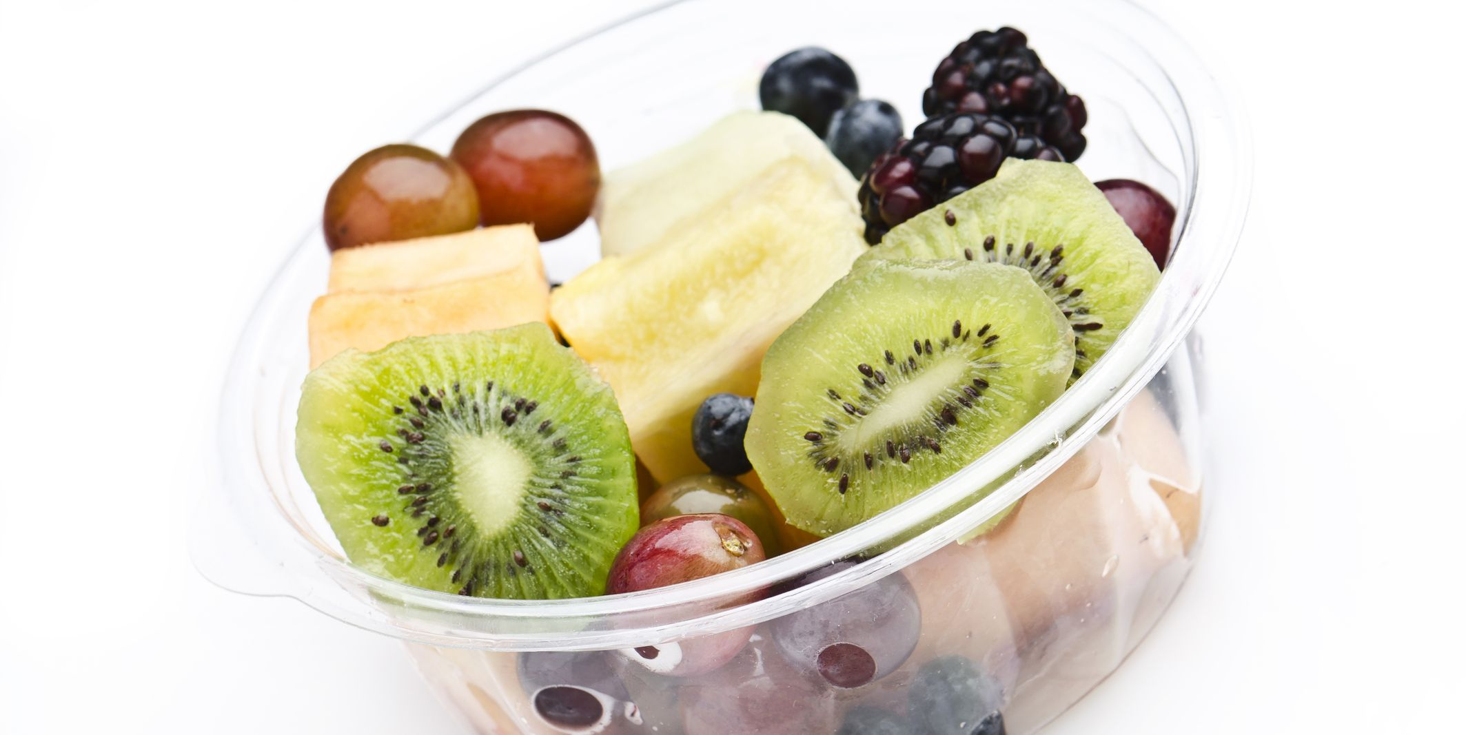 Plastic Tray of assorted fruits on white background