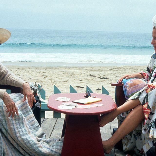 Human body, Sitting, Leisure, Outdoor furniture, Tourism, Furniture, Table, Outdoor table, Summer, Hat,