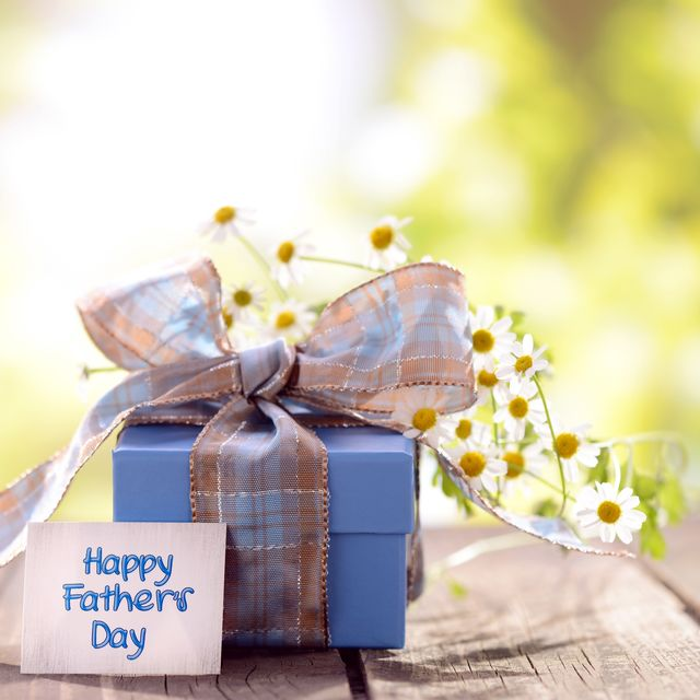 gift box and daisy flowers with a fathers day card