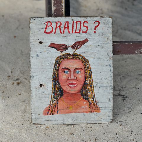 a sign for braids, a typical service provided for tourists when visiting the caribbean photo by universal educationuniversal images group via getty images