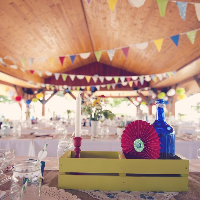 outdoor pavilion decorated for a party  fun use of banners, pinwheels, bottles and flowers