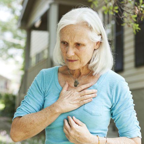 woman with symptoms of heartburn