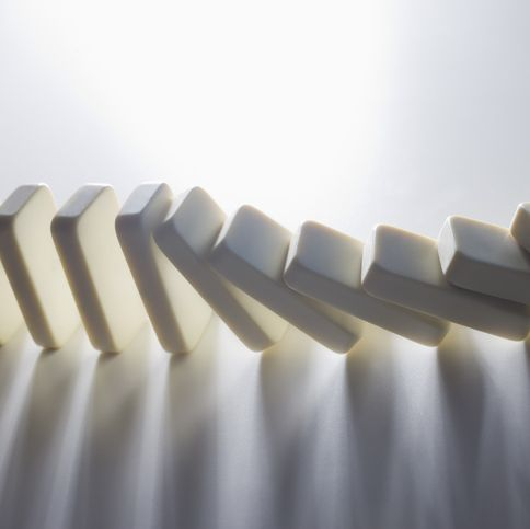 Close up of falling dominoes