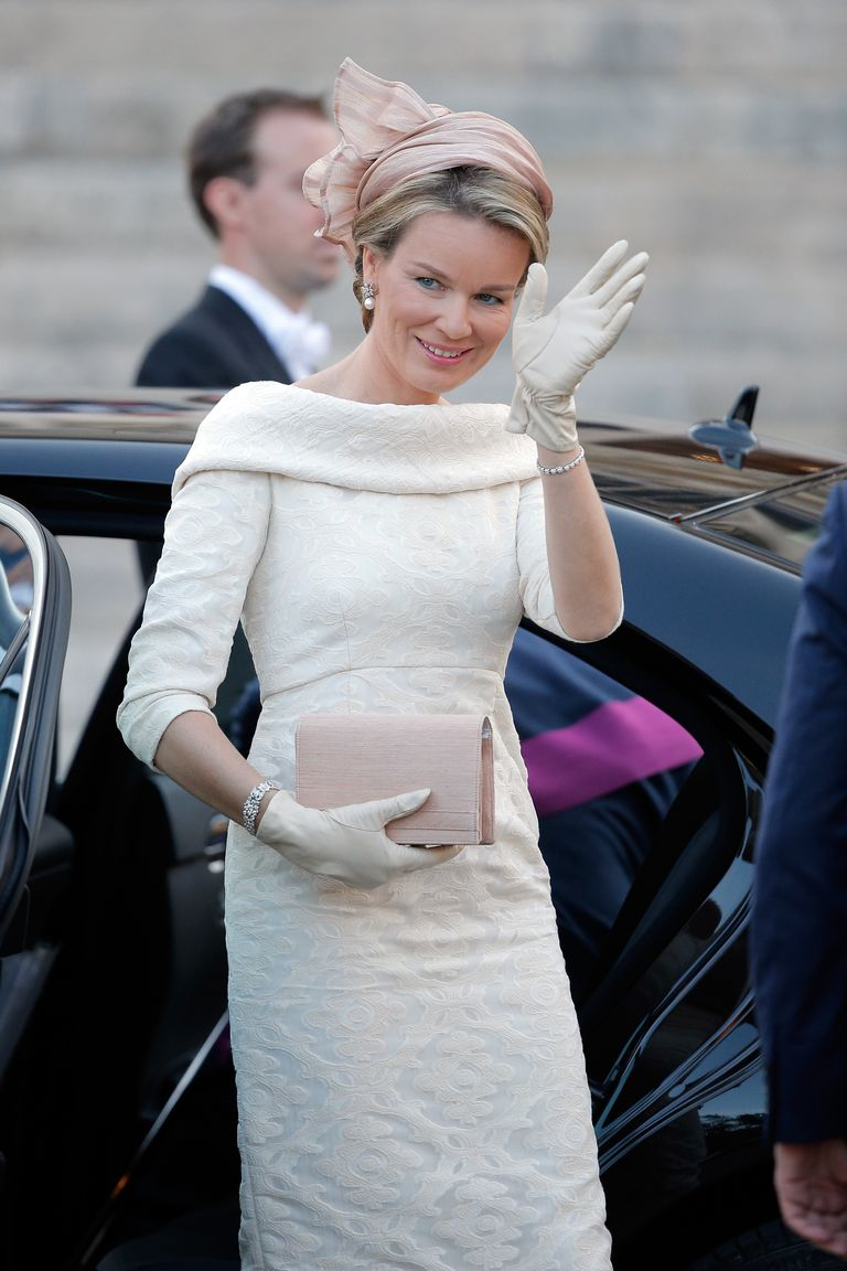 Queen Mathilde of Belgium carrying a Delvaux bag.