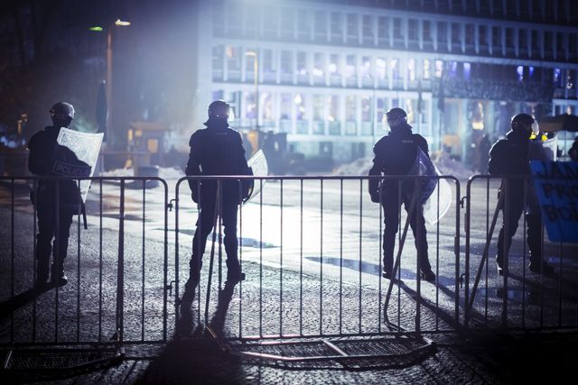 eastern europe riot police behind the fence