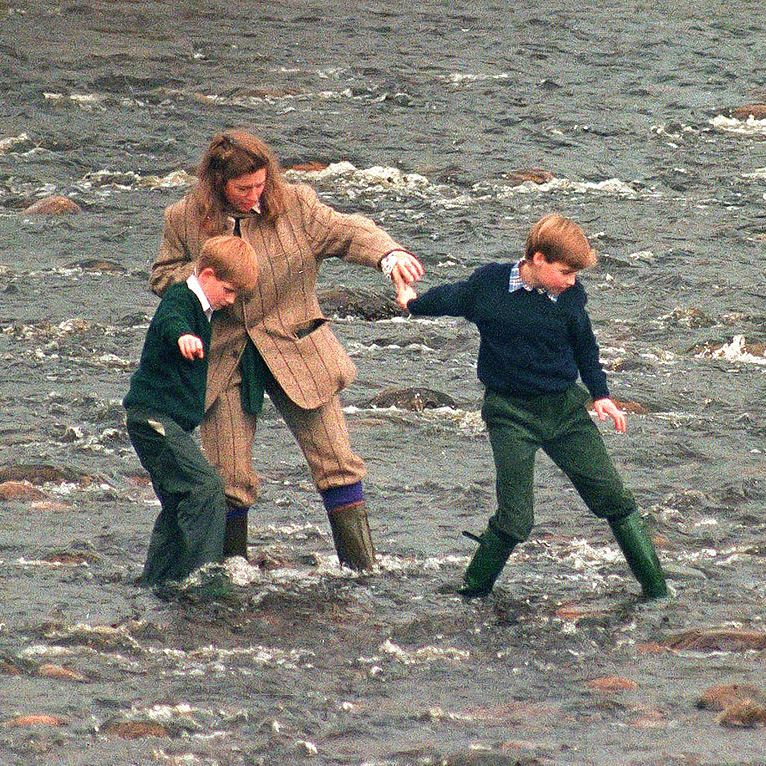 Prince William and Prince Harry with their nanny Tiggy Legge-Bourke taking a walk in the River Gairn, near the Queen's Scottish estate Balmoral, in 1994.