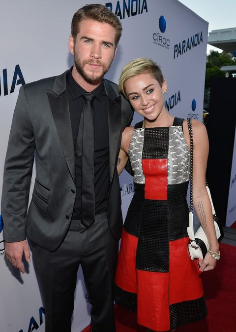 los angeles, ca   august 08  actor liam hemsworth and singer miley cyrus attend the premiere of relativity medias paranoia at dga theater on august 8, 2013 in los angeles, california  photo by frazer harrisongetty images for relativity media