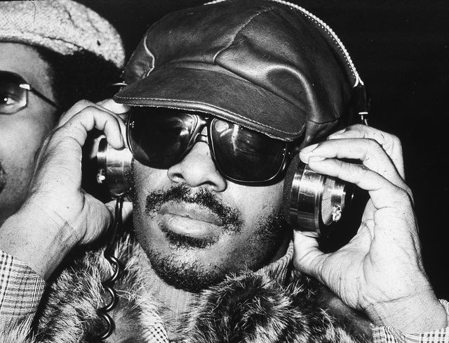 american singer and musician stevie wonder uses a pair of headphones, londong, england, 1974 photo by getty images
