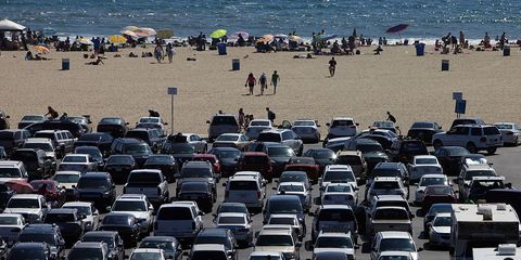 rows of parked cars sit by the beach at the santa monica pier in santa monica, california, us, on monday, aug 5, 2013 overall us tourism related sales increased 68 in the second quarter of 2013 as compared to 2012 photographer patrick fallonbloomberg via getty images