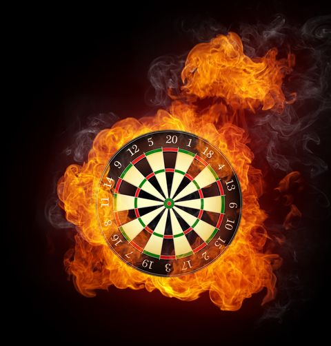darts board in fire isolated on black background