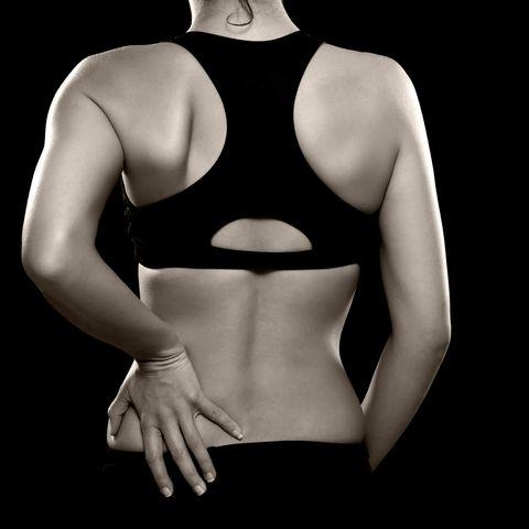 ovulation pain symptoms lower back ache