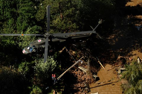 fema personal are hoisted into a uh 60 black hawk by us army soldiers during flooding in boulder colorado