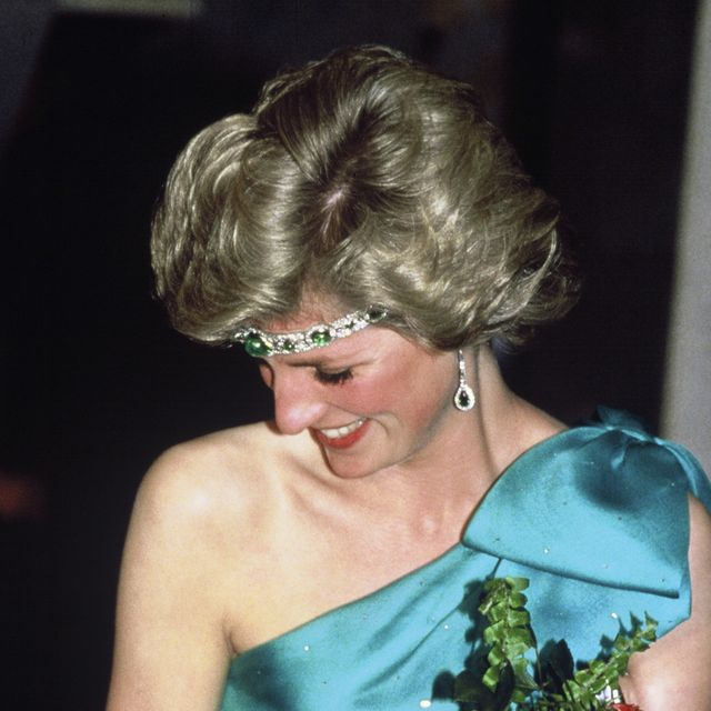 melbourne, australia   october 31 diana, princess of wales, wearing a green satin evening dress designed by david and elizabeth emanuel and an emerald necklace as a headband, attends a gala dinner dance at the southern cross hotel on october 31, 1985 in melbourne, australiaphoto by anwar husseingetty images